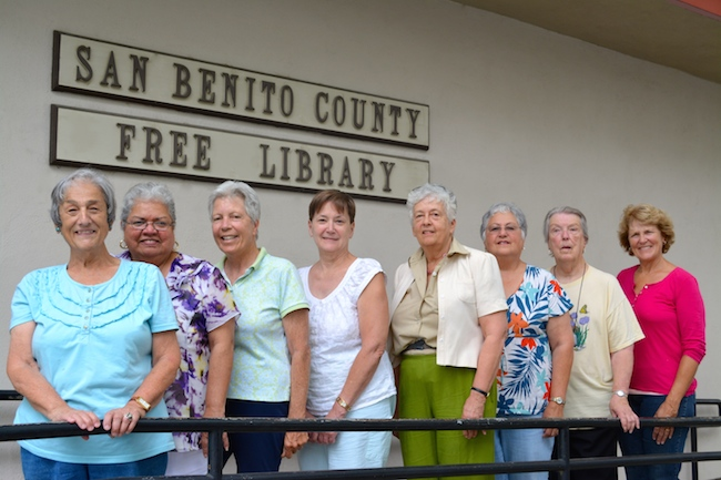 Members of the Friends of the Library pose in front of the San Benito County Free Library building.